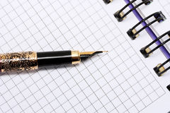 Pen on note books Royalty Free Stock Photo