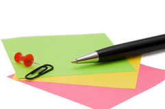 Pen and note isolated over white Stock Photo