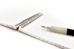 Pen and note pad Stock Photography