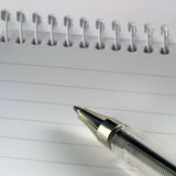Pen on note pad Stock Images