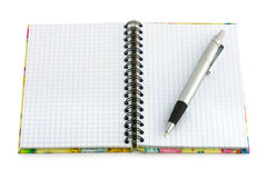Pen and note pad. Isolated on white background Royalty Free Stock Photos