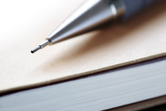 Pen on a note pad Stock Image
