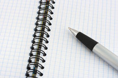 Pen and note pad Stock Photo