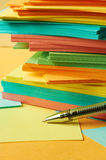 Pen with note paper. Pen with multicolor sheets of note paper Stock Image