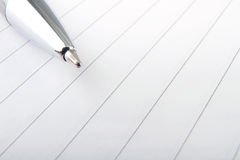 Pen and note paper Stock Image