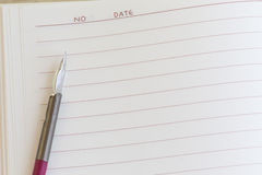 Pen with note paper Royalty Free Stock Images