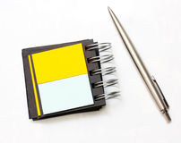 Pen beside note Stock Photography