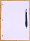 Pen on Notebood Paper Royalty Free Stock Images