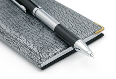 Pen and notebook. A pen and notebook on a white background Stock Images