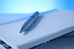 Pen and notebook. Modern and luxury silver pen and notebook isolated Stock Images