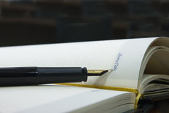Pen and notebook. The opened notebook with pen  which feather is specified in an inscription by Date Royalty Free Stock Photography