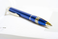Pen on the notebook Royalty Free Stock Photos