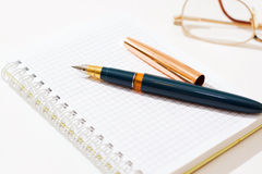 The  pen and notebook Stock Image