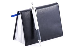 Pen and notebook. Isolated on a white background Royalty Free Stock Photos