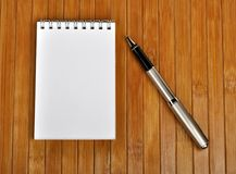 Pen and notebook Stock Photos