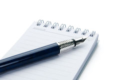 Pen on notebook. Pen on notebook, isolated on white background Royalty Free Stock Image