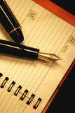 Pen on a notebook. Pen on an organiser, business concept Royalty Free Stock Images