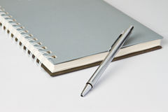 Pen on notebook Royalty Free Stock Images