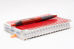 Pen and notebook Stock Image