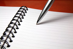 Pen and Notebook Stock Images