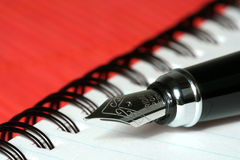 Pen with notebook Stock Image