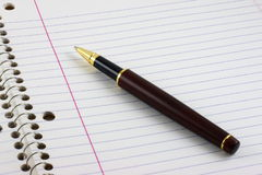 Pen on lined notebook Stock Images
