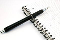 Pen and notebook. On white background stock photos