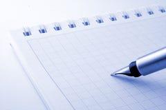 Pen & notebook royalty free stock photos