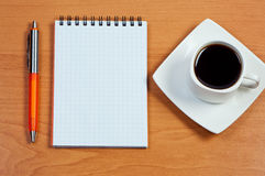 Pen, Notebook And Cup Coffee On Table. Royalty Free Stock Photo