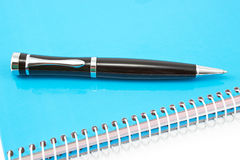 Pen on notebook Stock Image