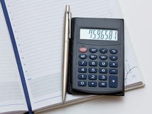 Pen, notebook, calculator. A closeup of personal organizer, pen and calculator on white background Stock Photo