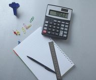 Pen on notebook and calculator stock image