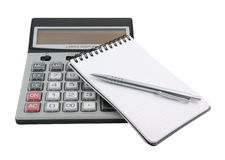 Pen on notebook and calculator isolated Stock Photography