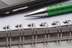 Pen, notebook and cell phone Royalty Free Stock Photo
