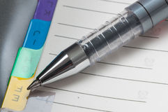 Pen and notebook. Close up Stock Photo