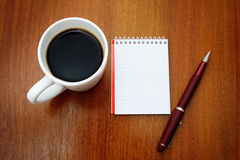 Pen, notebook and coffee Royalty Free Stock Image