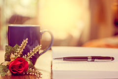 Pen on notebook and coffee cup, flower. Stock Photography