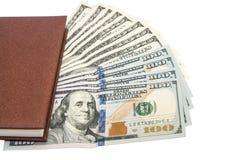 Pen, notebook, dollar bills Stock Photos