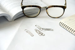 Pen notebook and eyeglasses Stock Photo