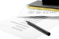 A pen, notebook and financial statement Stock Images