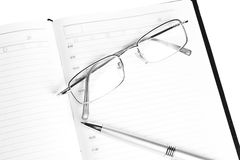 Pen, notebook and glasses Royalty Free Stock Photo