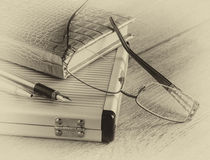 Pen notebook and glasses in composition, black and white Royalty Free Stock Photo
