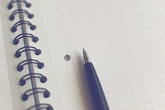 Pen on notebook. Pen lying on a piece of paper Royalty Free Stock Photos