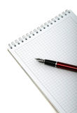 Pen and notebook for notes on a white background. Royalty Free Stock Photos