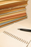 Pen, notebook and old books Royalty Free Stock Photos