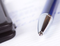 Pen on notebook page Royalty Free Stock Photo