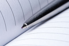 Pen on notebook pages close-up. Stock Photo