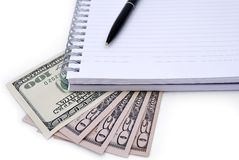 Pen, Notebook and some dollars Stock Photo