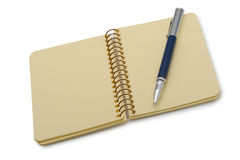Pen and a notebook on a spiral with a yellow paper Royalty Free Stock Photos