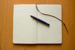 Pen on the notebook Stock Image